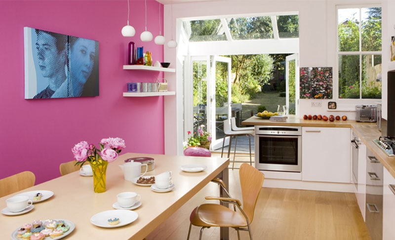 If you're daring, adding a bright feature wall to your home is a great way to add life to your design without breaking the bank - Source: www.amberth.co.uk